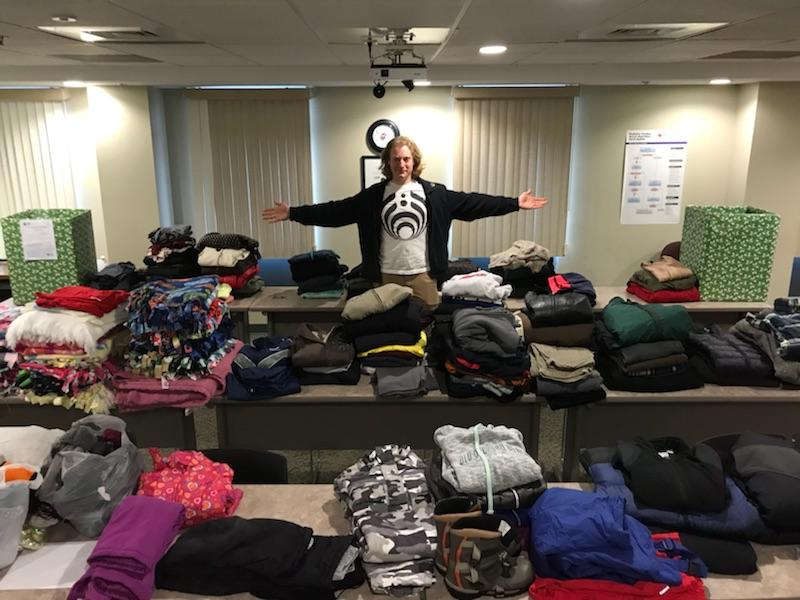 Armstrong EMT, Alex Cristofori organizing donated winter clothing.