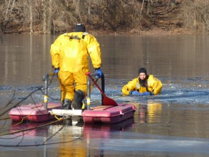 "Medford firefighter uses an ice rescue sled to make his way towards the ""victim""."