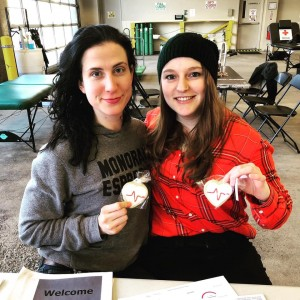 American Red Cross Ambassador and Armstrong EMT Elysia Heilig and Armstrong EMT/EMD Kari Smith with their Armstrong staright from the heart pulse cookies.