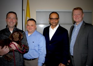 From left: Armstrong Ambulance CEO Rich Raymond (holding Willie), St. Elizabeth's EMS Manager Jeff Scafidi, Dr. Sush Prusty and Armstrong Director of Clinical Integration Ben Podsiadlo.