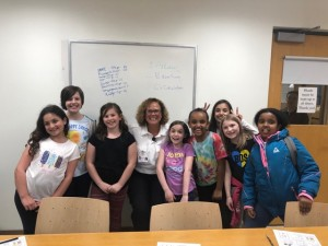 Armstrong Paramedic Stephanie Crayton (center) met with her neighbor's Girl Scouts troop in order to help them earn their first aid badges.