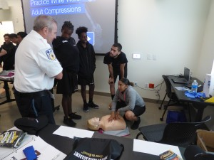 Armstrong's Larry LeDoux shares lifesaving techniques with Boston College Police Youth Academy cadets.