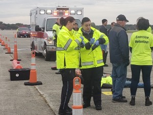 "Armstrong Paramedic Lori Beth Sterling-Elliot and EMT Jessica Phinney coordinating ""victim"" triage at the aircraft scene"